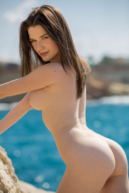 Beautiful young angel Serena getting naked at the beach