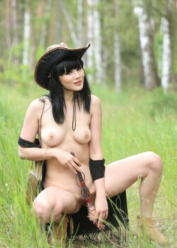 Sexy Asian cowgirl Malena fabulous body nude on the ranch