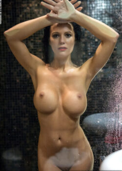 Super busty nude babe in the shower